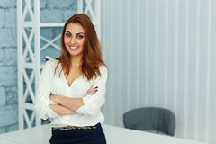 Young beautiful businesswoman standing with arms folded Royalty Free Stock Images