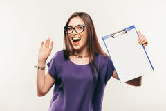 Young beautiful businesswoman student in glassses holding a folder royalty free stock photography