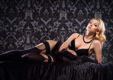 Young and beautiful cabaret dancer in vintage lingerie Royalty Free Stock Photography