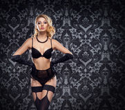 Young and beautiful cabaret dancer in sexy vintage lingerie Stock Photos