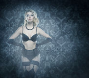 Young and beautiful cabaret dancer in sexy vintage lingerie Royalty Free Stock Photo