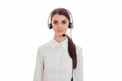 Young beautiful call office girl in white shirt with headphones isolated on  background in studio Stock Photo