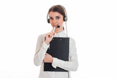 Young beautiful call office girl in white shirt with headphones and tablet isolated on  background in studio Stock Photos