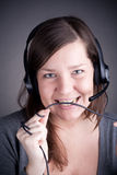 Young and beautiful callcenter agent Royalty Free Stock Images