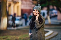 Young beautiful casual girl calling on her cell phone  on  spring city street Stock Photos
