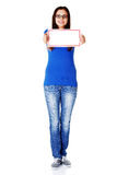 Young beautiful casual woman holding copy space. Royalty Free Stock Photo