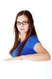 Young beautiful casual woman holding copy space. Royalty Free Stock Photography