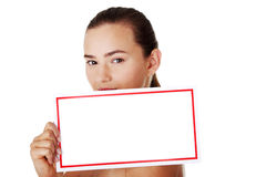Young beautiful casual woman holding copy space. Royalty Free Stock Image