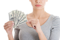 Young beautiful casual woman holding large sum of money. Stock Photography