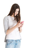 Young beautiful casual woman with mobile phone. Isolated on white Stock Images