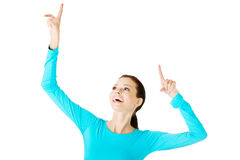 Young beautiful casual woman pointing up. Stock Image
