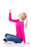 Young beautiful casual woman pointing up. Royalty Free Stock Photo