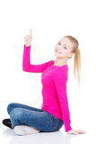 Young beautiful casual woman pointing up. Stock Photo