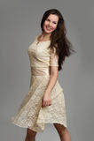 Young beautiful caucasian brunette in dress Royalty Free Stock Photography