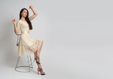 Young beautiful caucasian brunette in dress Stock Images