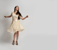 Young beautiful caucasian brunette in dress Stock Photography