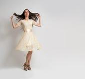 Young beautiful caucasian brunette in dress Stock Photos
