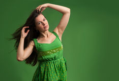 Young beautiful caucasian brunette in green dress Royalty Free Stock Photos