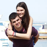 Young beautiful caucasian couple hugs and kiss - first love in s Royalty Free Stock Images