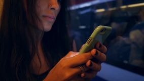 Young Beautiful Caucasian Girl Texting on Mobile Phone in Metro Subway Train. 4K. Young Beautiful Caucasian Girl Texting on Mobile Phone in Metro Subway Train stock video footage