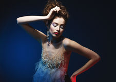 Young beautiful caucasian model in gorgeous dress. Motion shot stock images