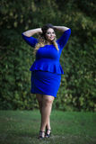 Young beautiful caucasian plus size fashion model in blue dress outdoors, xxl woman on nature Stock Photography