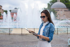 Young beautiful caucasian traveling woman reading Royalty Free Stock Photography