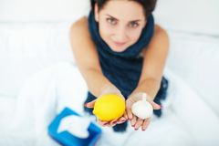 Young beautiful Caucasian woman on bed having headache / insomni Stock Images
