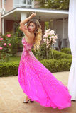 Young beautiful caucasian woman in gorgeous dress. blond girl ma Stock Photos