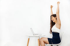 Young beautiful Caucasian woman having arms raised up as she has won over something in white isolated background with copy space Royalty Free Stock Photos