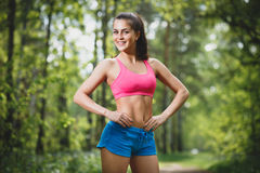 Young beautiful caucasian woman jogging in summer park Royalty Free Stock Photo