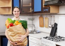 Young beautiful caucasian woman in the kitchen Stock Photography