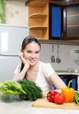 Young beautiful caucasian woman in the kitchen Stock Images