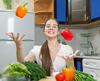 Young beautiful caucasian woman in the kitchen Royalty Free Stock Image