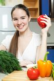 Young beautiful caucasian woman in the kitchen Royalty Free Stock Images