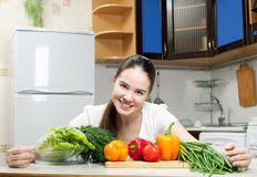 Young beautiful caucasian woman in the kitchen Royalty Free Stock Photo