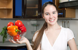 Young beautiful caucasian woman in the kitchen Stock Image