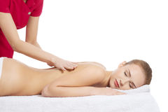 Young beautiful caucasian woman lying on a massage table and is Royalty Free Stock Photos