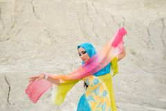 Young beautiful Caucasian woman posing in arabian costume in Empty Quarter desert dancing royalty free stock photos