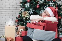 Young beautiful Caucasian woman, in red santa hat,sleeping and h royalty free stock photo
