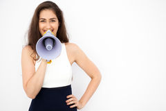 Young beautiful Caucasian woman shouting and making announcement with megaphone in white  background.  Stock Images