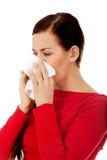 Young beautiful caucasian woman sneezing Stock Photos