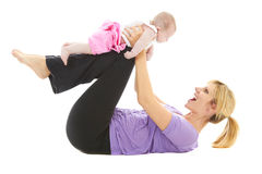 Young beautiful caucasion mom doing baby yoga Royalty Free Stock Images
