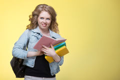 Young beautiful cheerful student girl Stock Photography