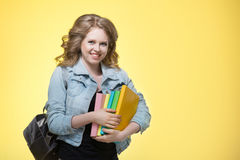 Young beautiful cheerful student girl Royalty Free Stock Image
