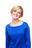 Young beautiful cheerful woman in blue sweater Stock Photo