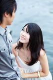 Young beautiful Chinese girl enjoys intimacy Royalty Free Stock Photos