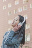Young beautiful Chinese girl with headphones Stock Photos
