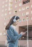 Young beautiful Chinese girl with headphones Stock Image
