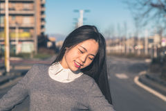 Young beautiful Chinese girl posing in the city streets Royalty Free Stock Photos